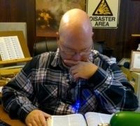 Pastor Steve reading Bible in his Office